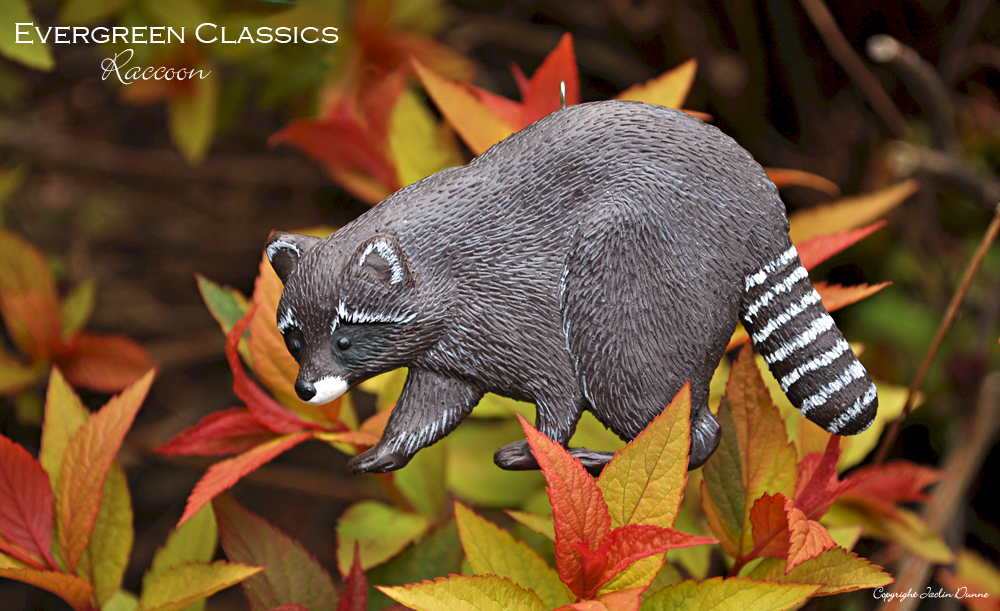 Raccoon floral decoration agaist autumn leaves.